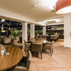 Отель Ozo Hotel Нидерланды, Амстердам - 9 отзывов об отеле, цены и фото номеров - забронировать отель Ozo Hotel онлайн гостиничный бар