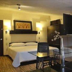 Aztic Hotel And Executive Suites Мехико комната для гостей фото 2