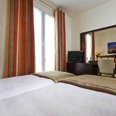 Grand Hotel Des Balcons Париж комната для гостей