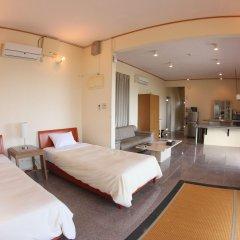 Отель Cottage Seaside Центр Окинавы комната для гостей фото 2