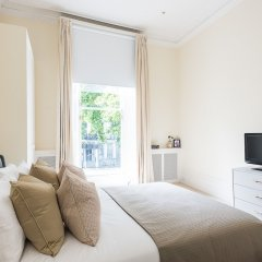 Апартаменты Huge, Regal 2BR Apartment Right next to Harrods! Лондон комната для гостей фото 3