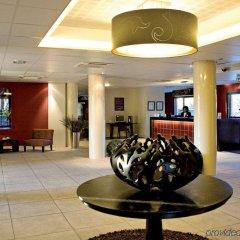 Отель Appart'City Confort Toulouse Aéroport Blagnac Франция, Бланьяк - отзывы, цены и фото номеров - забронировать отель Appart'City Confort Toulouse Aéroport Blagnac онлайн интерьер отеля