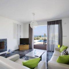 Отель Paradise Cove Luxurious Beach Villas Кипр, Пафос - отзывы, цены и фото номеров - забронировать отель Paradise Cove Luxurious Beach Villas онлайн комната для гостей фото 2