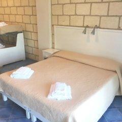 Отель CapoSperone Resort Италия, Пальми - отзывы, цены и фото номеров - забронировать отель CapoSperone Resort онлайн комната для гостей фото 2