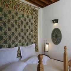 Отель Melenos Lindos Exclusive Suites and Villas сейф в номере