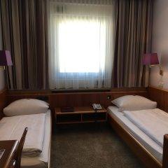 Отель Hauser an der Universität Германия, Мюнхен - 1 отзыв об отеле, цены и фото номеров - забронировать отель Hauser an der Universität онлайн комната для гостей