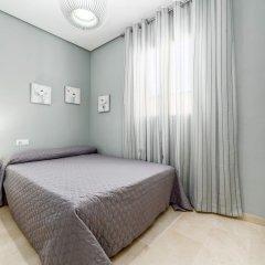 Отель Apartamento Travel Habitat Ático Comedias комната для гостей