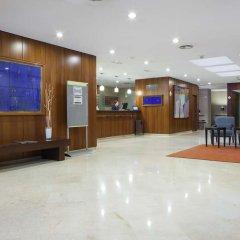 Отель NH Ciudad de Valencia интерьер отеля