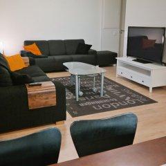 Апартаменты Local Nordic Apartments - Arctic Fox Ювяскюля комната для гостей