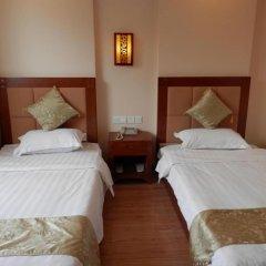 Отель Chinese Culture Holiday Hotel - Nanluoguxiang Китай, Пекин - отзывы, цены и фото номеров - забронировать отель Chinese Culture Holiday Hotel - Nanluoguxiang онлайн комната для гостей фото 3