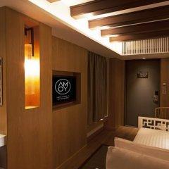 Отель AMOY by Far East Hospitality сейф в номере