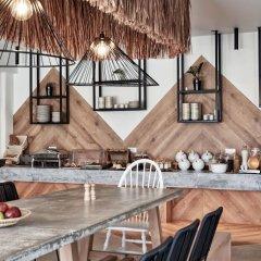 Отель Naxian Utopia Luxury Villas & Suites гостиничный бар