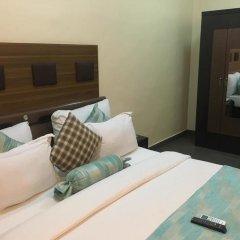 Отель Cynergy Suites Royale комната для гостей