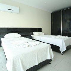 Апартаменты Orka Royal Hills Apartment Олудениз комната для гостей фото 2