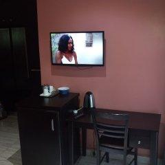 Отель Hard Break Hotel and Suite Нигерия, Энугу - отзывы, цены и фото номеров - забронировать отель Hard Break Hotel and Suite онлайн удобства в номере