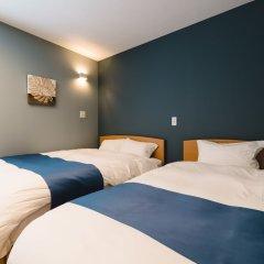 Отель Trip Base HAKATAEKIMAE Хаката комната для гостей фото 3