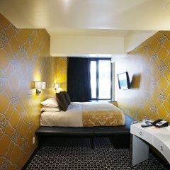 Room Mate Grace Boutique Hotel комната для гостей