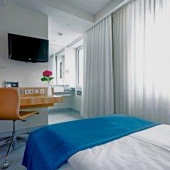 Отель Lindner Hotel Am Ku'damm Германия, Берлин - 9 отзывов об отеле, цены и фото номеров - забронировать отель Lindner Hotel Am Ku'damm онлайн удобства в номере фото 2
