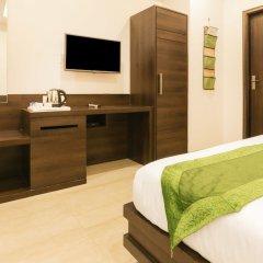Отель Treebo Trend Bliss Raja Park удобства в номере фото 2