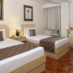 Отель City Garden Suites Manila Филиппины, Манила - 1 отзыв об отеле, цены и фото номеров - забронировать отель City Garden Suites Manila онлайн комната для гостей фото 5