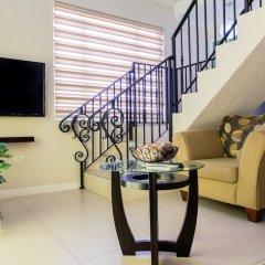 Отель Eight 24 by Pro Homes Jamaica Ямайка, Кингстон - отзывы, цены и фото номеров - забронировать отель Eight 24 by Pro Homes Jamaica онлайн интерьер отеля