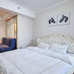Отель Holiday Apartment Hotel Китай, Шэньчжэнь - отзывы, цены и фото номеров - забронировать отель Holiday Apartment Hotel онлайн комната для гостей фото 2