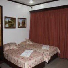 Отель Cebu Residencia Lourdes Филиппины, Лапу-Лапу - отзывы, цены и фото номеров - забронировать отель Cebu Residencia Lourdes онлайн комната для гостей