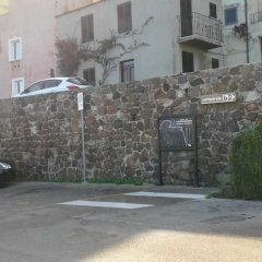 Отель Appartamenti Eleonora D'Arborea Кастельсардо парковка