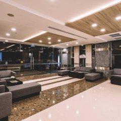 Отель Adelphi Suites Bangkok интерьер отеля фото 3