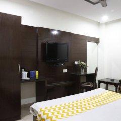 Отель OYO 16011 Hotel Mohan International Индия, Нью-Дели - отзывы, цены и фото номеров - забронировать отель OYO 16011 Hotel Mohan International онлайн удобства в номере фото 2