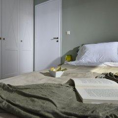 Отель Karyatis Luxury Maisonette by K&K комната для гостей