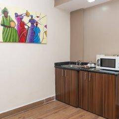 Отель Hawthorn Suites By Wyndham Abuja удобства в номере фото 2