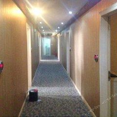 Ruichang Xingainian Hotel 1st интерьер отеля