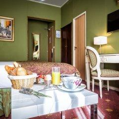 Отель Le Regence Париж в номере фото 2