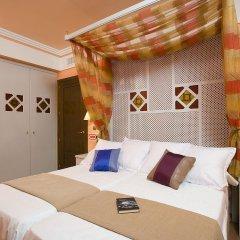 Отель Suites Gran Via 44 Apartahotel комната для гостей
