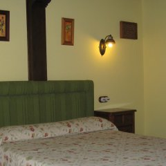 Отель Posada El Jardin de Angela сейф в номере