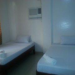 Отель Seasons Guesthouse Филиппины, Пуэрто-Принцеса - отзывы, цены и фото номеров - забронировать отель Seasons Guesthouse онлайн комната для гостей фото 3