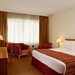 Отель Swiss-Belhotel Sharjah комната для гостей фото 4