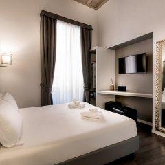Отель Borgofico Relais & Wellness сейф в номере