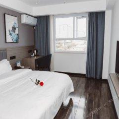Отель 7 Days Inn Xian Dong Da Jie Jian Guo Road комната для гостей