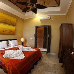 Отель Bayshore Villas Candi Dasa Индонезия, Бали - отзывы, цены и фото номеров - забронировать отель Bayshore Villas Candi Dasa онлайн сейф в номере