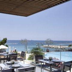 Отель The Royal Apollonia бассейн фото 3
