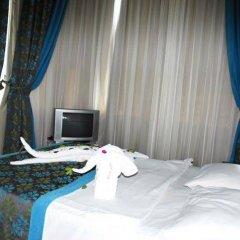Rosella Hotel сейф в номере