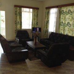 Отель Holiday Lodge Сьерра-Леоне, Фритаун - отзывы, цены и фото номеров - забронировать отель Holiday Lodge онлайн комната для гостей фото 4