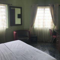 Отель Pentagon Luxury Suites Enugu Энугу удобства в номере