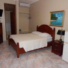Отель Garant & Suites Бока Чика сейф в номере