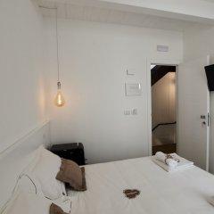 Отель Iulius Suite & spa Конверсано сейф в номере