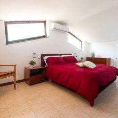 Отель Bed and Breakfast Letterario Италия, Фьюмичино - отзывы, цены и фото номеров - забронировать отель Bed and Breakfast Letterario онлайн комната для гостей