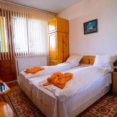 Отель Topuzovi Guest House Банско комната для гостей фото 5