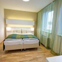 Отель Smart Apart Living Австрия, Вена - отзывы, цены и фото номеров - забронировать отель Smart Apart Living онлайн комната для гостей фото 5